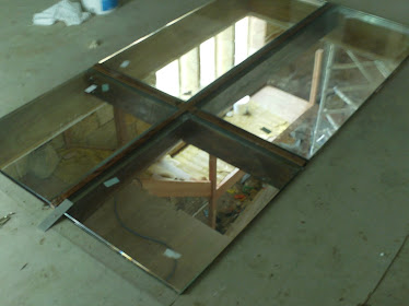 the 4 panels of 32mm toughened laminated glass to create the crucifix floor light panel