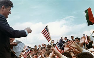 John F Kennedy greeted by crowds waving American flags in Ireland (Photo: JFK50Ireland)