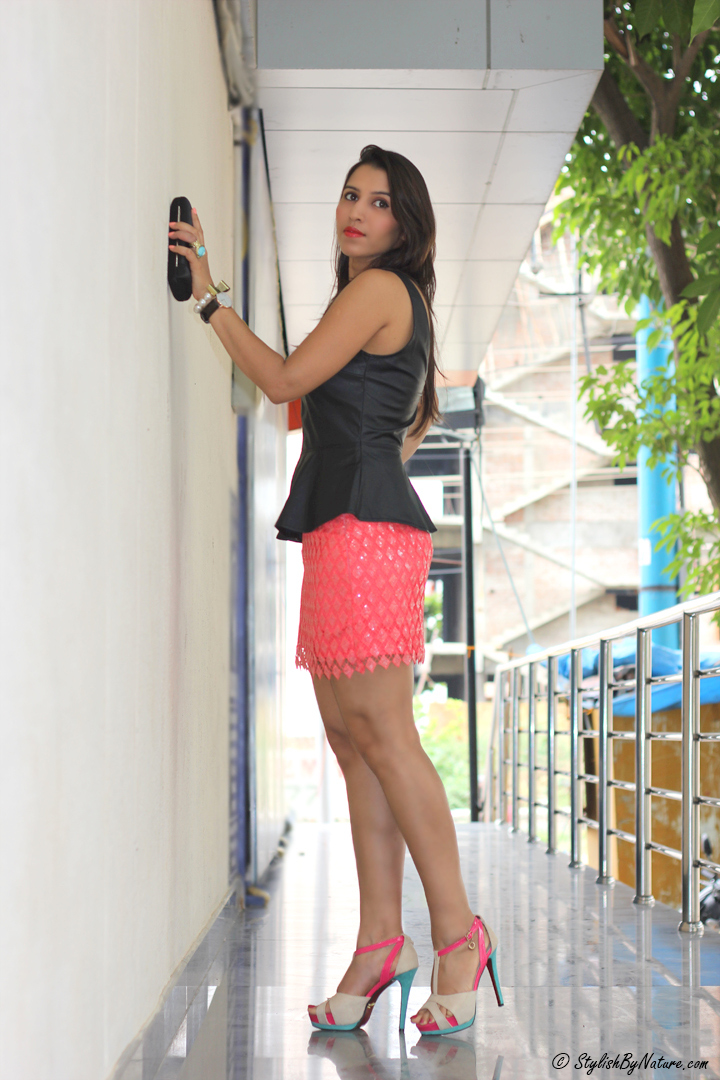 Leather Peplum top, Lace skirt, color-block heels, coral lipstick