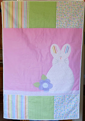 baby quilt with applique bunny and flower