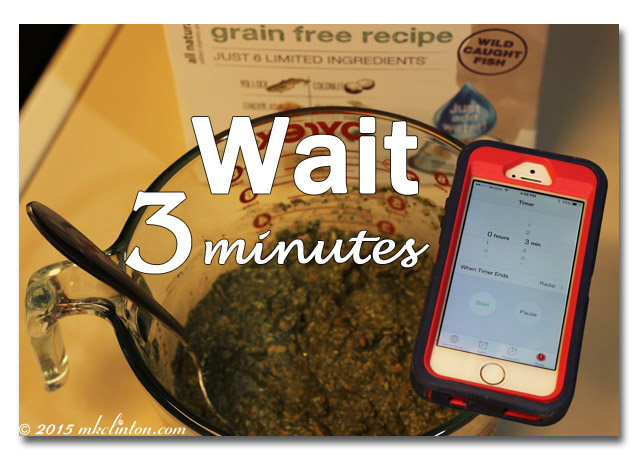 Brave dog food with stopwatch on iPhone set for 3 minutes