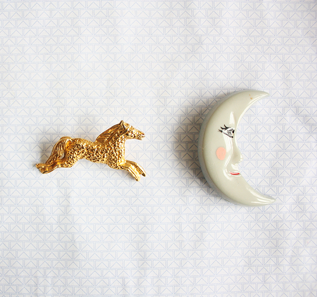 horse and moon brooches