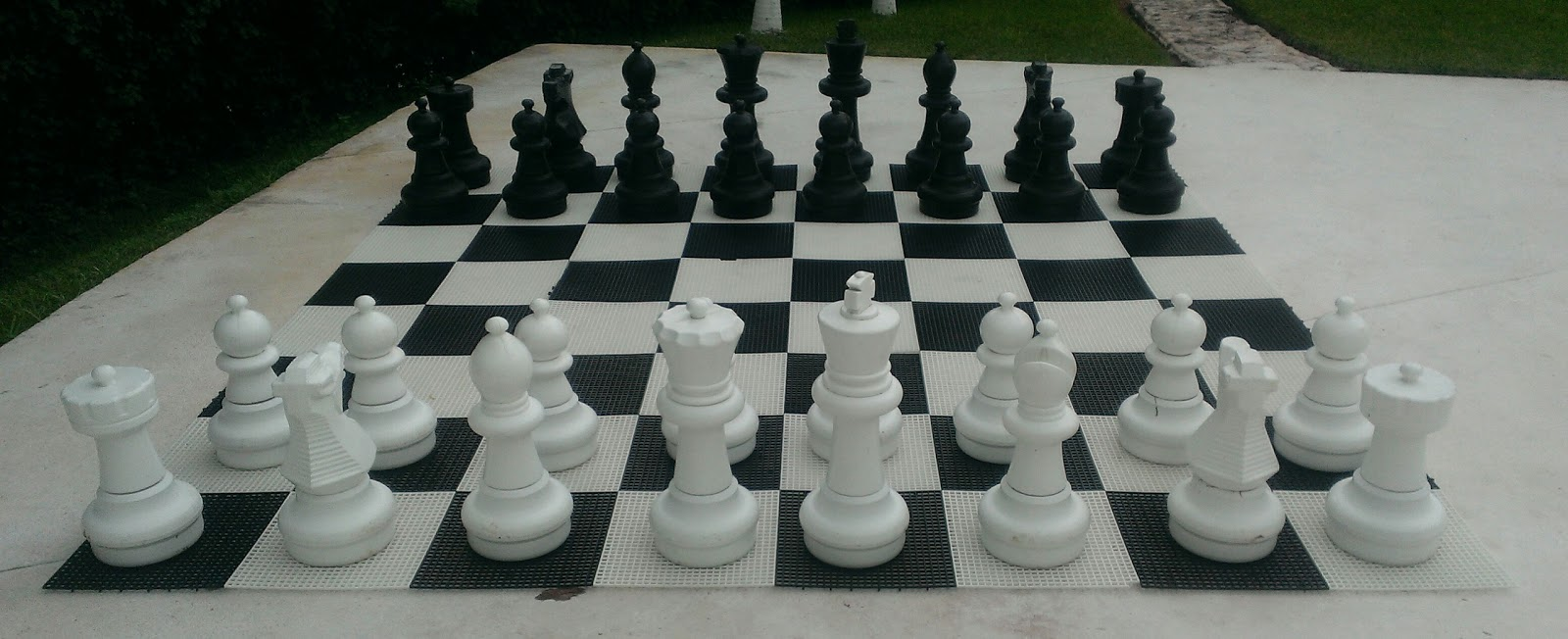 people sized chess set with pieces in home position