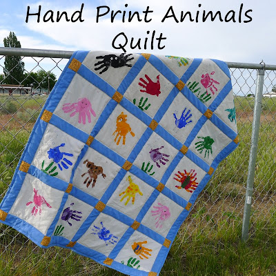 http://www.piecesbypolly.com/2011/06/hand-print-animals-quilt.html