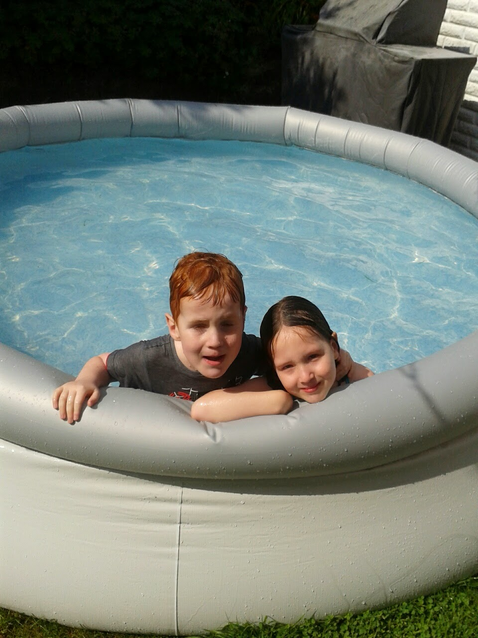 Caitlin and Ieuan in the paddling pool