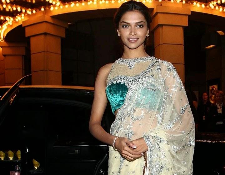 Deepika Padukone side view if her big round cleavage and navel show through her transaprent white saree