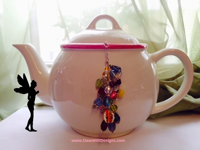 This tea ball has mutliple colors on the chain to keep it from falling into the pot!