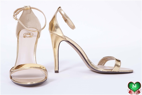 nigerian made. gold ankle strap heels, single sole