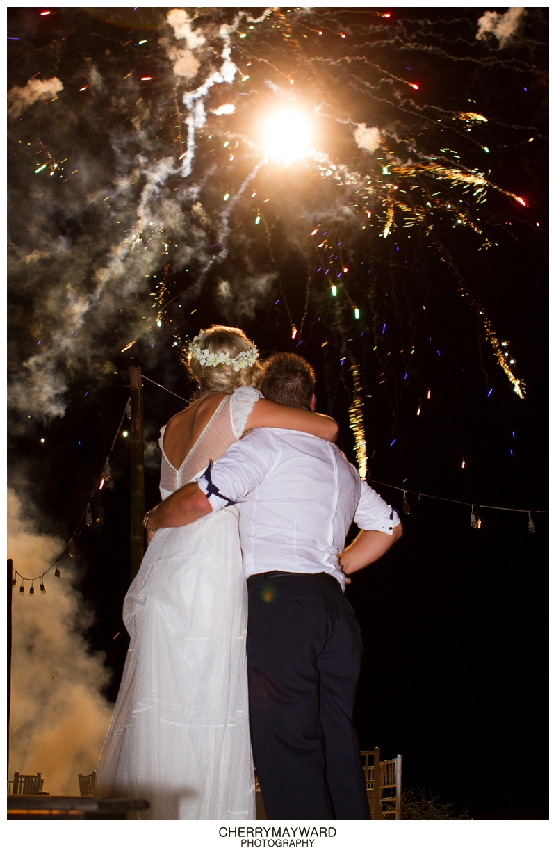 Bride and groom watching fireworks at Koh Samui, Thailand Destination wedding planning by Partners Samui