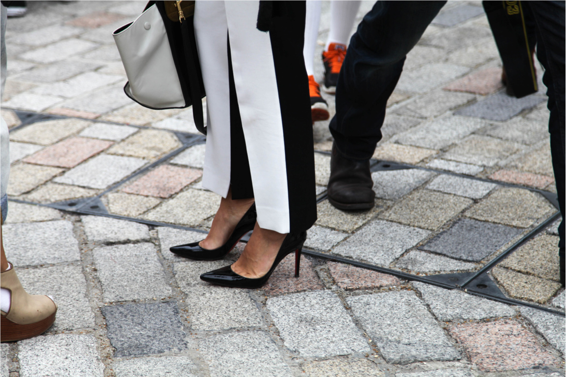 London Fashion Week street style black and white pants and black patent pumps