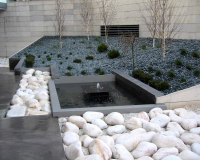 Jardiner a mundo verde decoracion de jardines con piedras for Precio piedras jardin