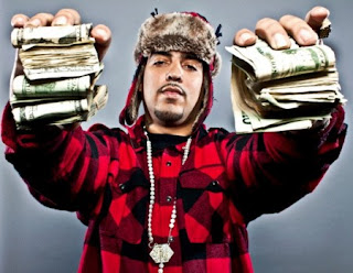 French Montana holding money