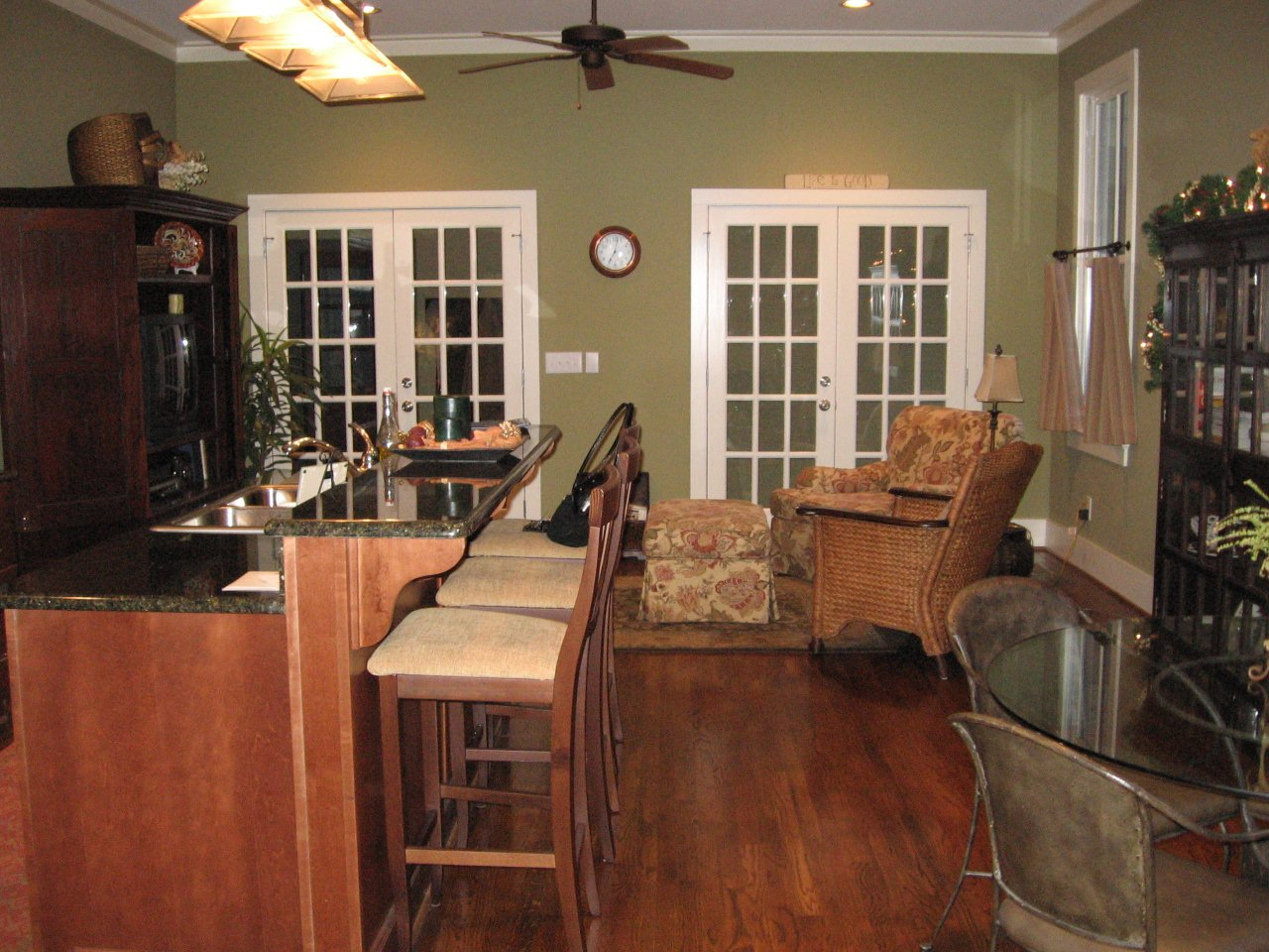 Olive Green Painted Kitchen Cabinets The cabinetry was designed and