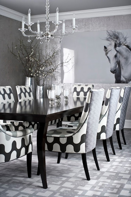 Grey dining room by Muse Interiors with graphic carpeting and chairs