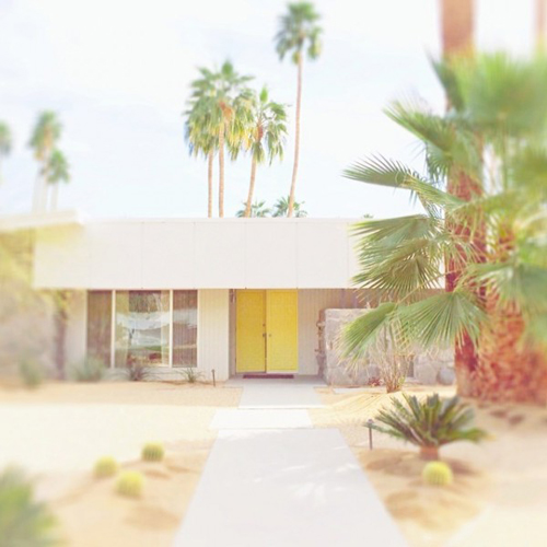 Palm Springs mid century home with yellow door