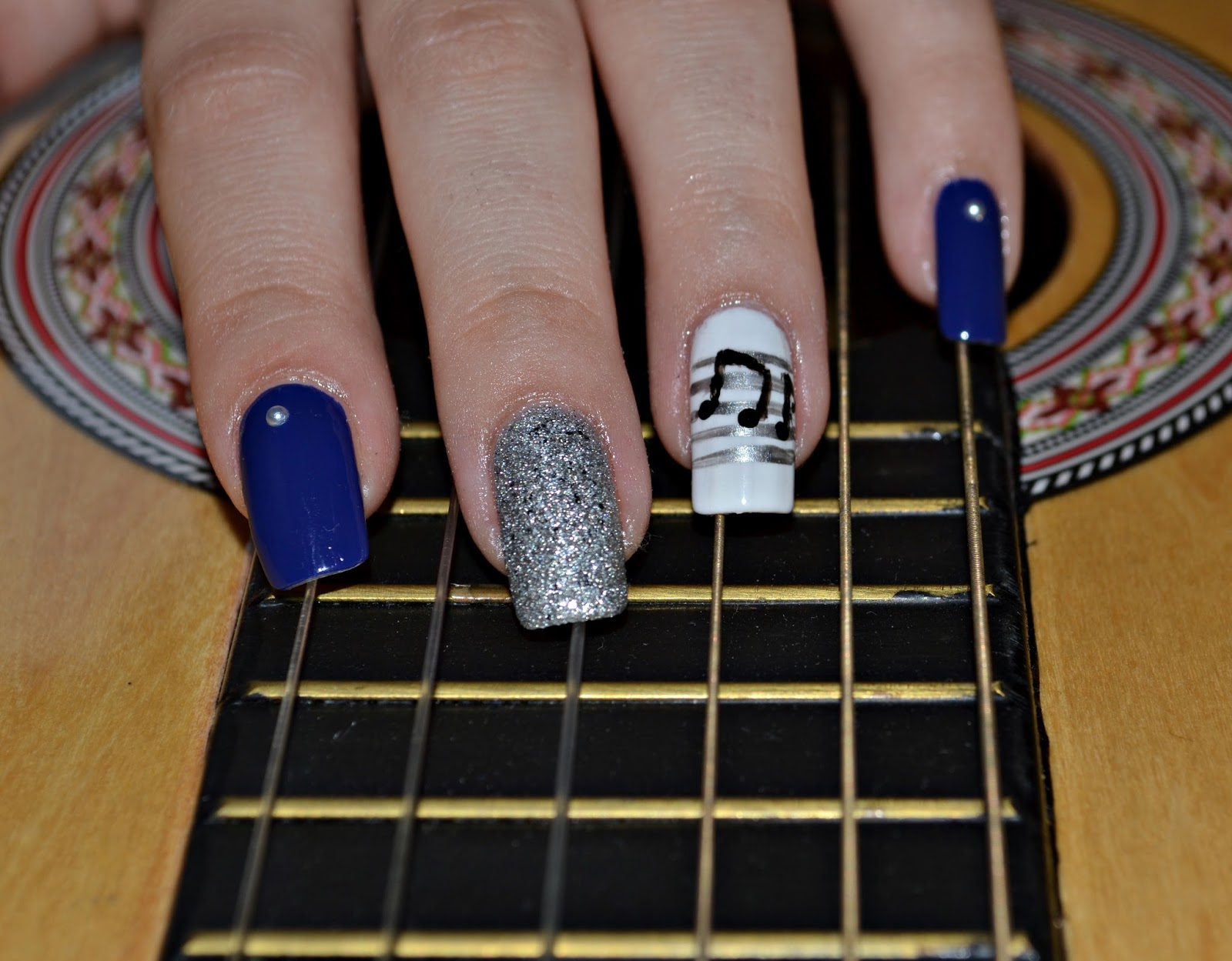 blue manicure music notes guitar
