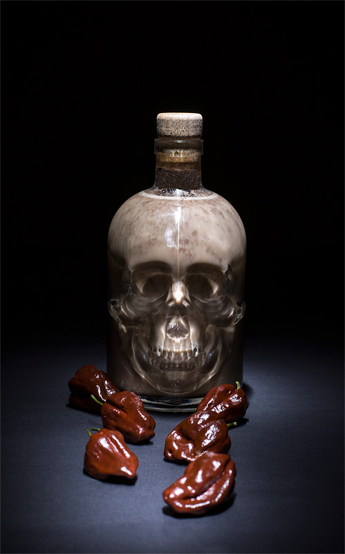Chocolate liquor with chili scull in dark
