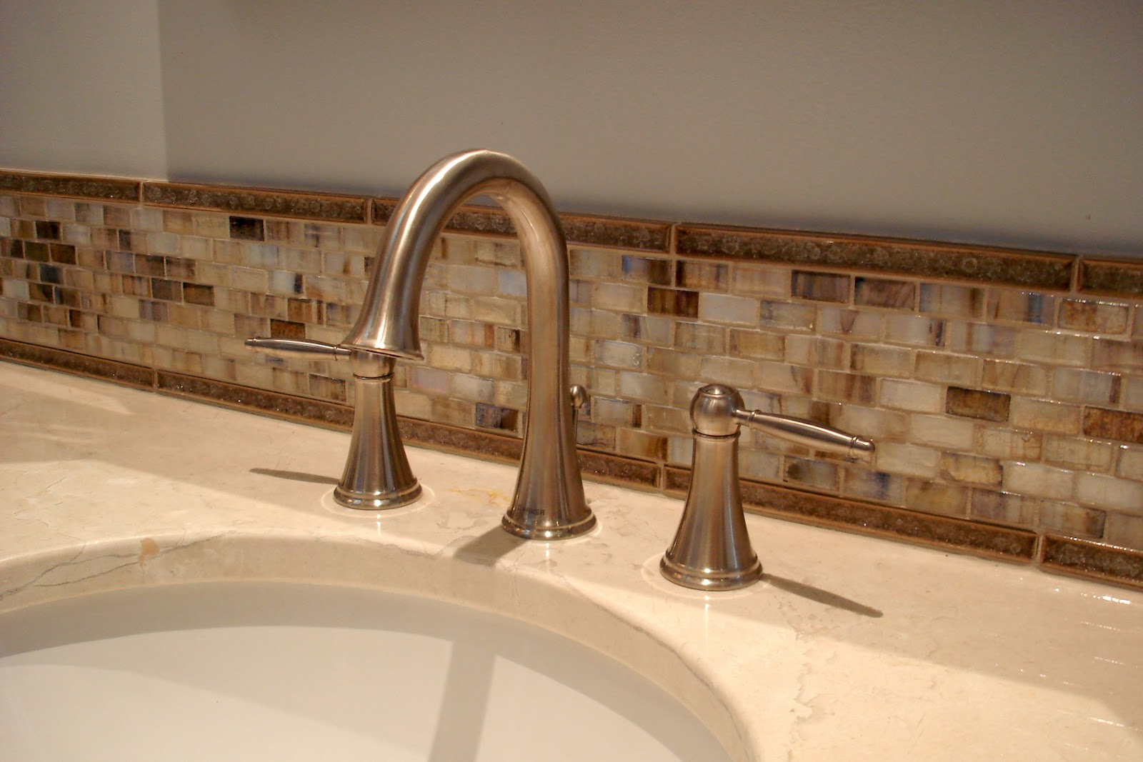 A touch of glass essence design studios llc for Bathroom backsplash