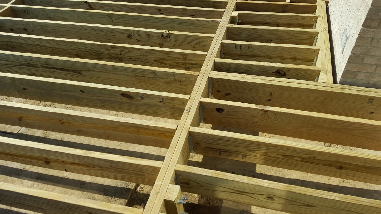 Outdoor living how to build a low to the ground deck for Balcony joists