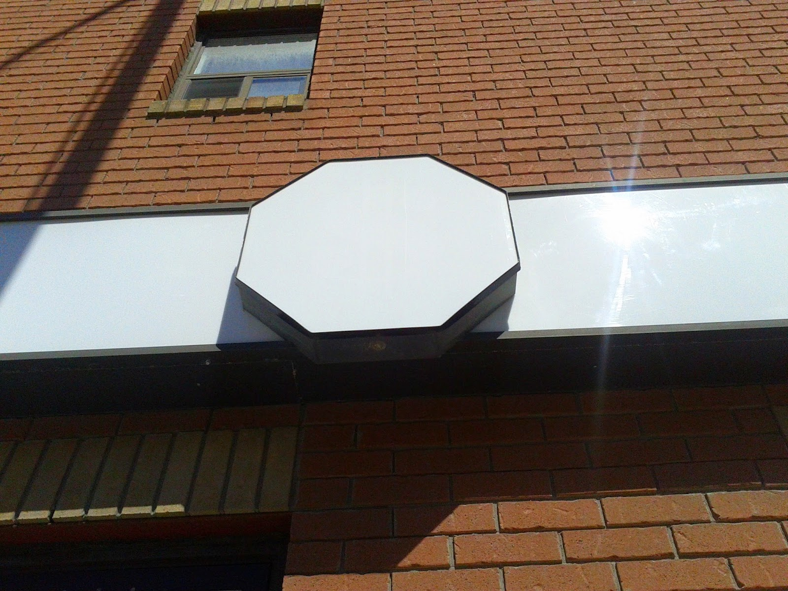 Stock photo: White octagon sign