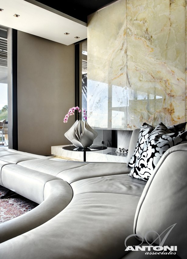 Curved white sofa in Head Road 1843 by Antoni Associates