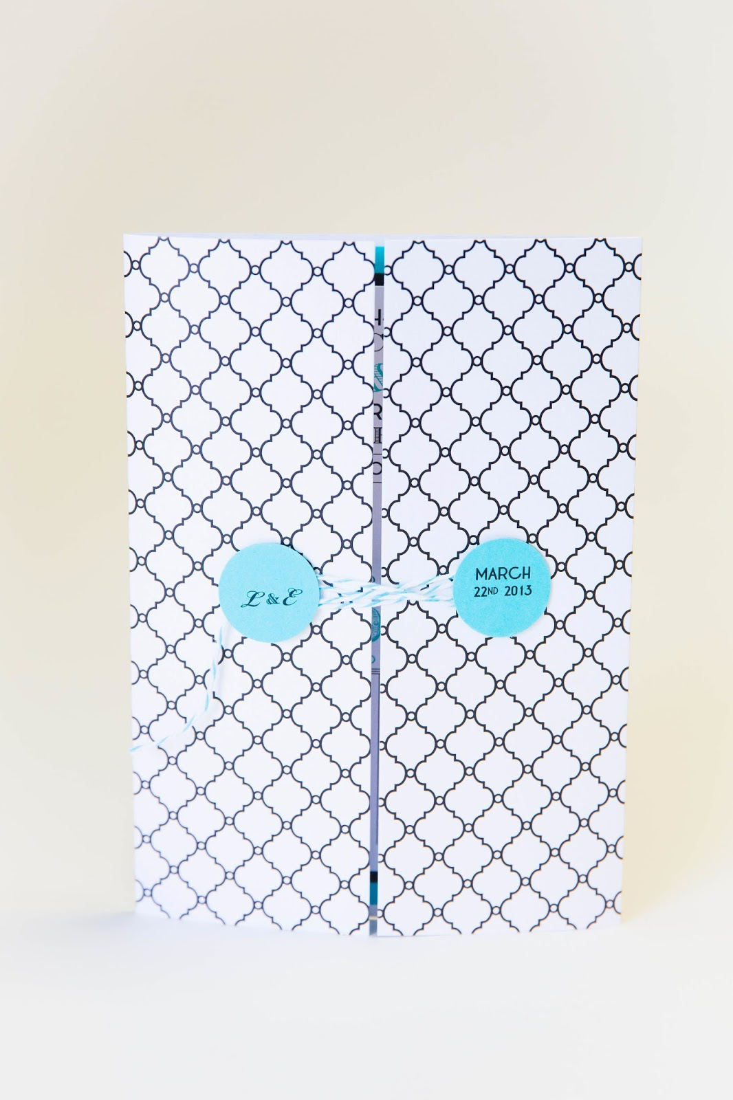 gate fold invitation casa blanca pattern string to close it