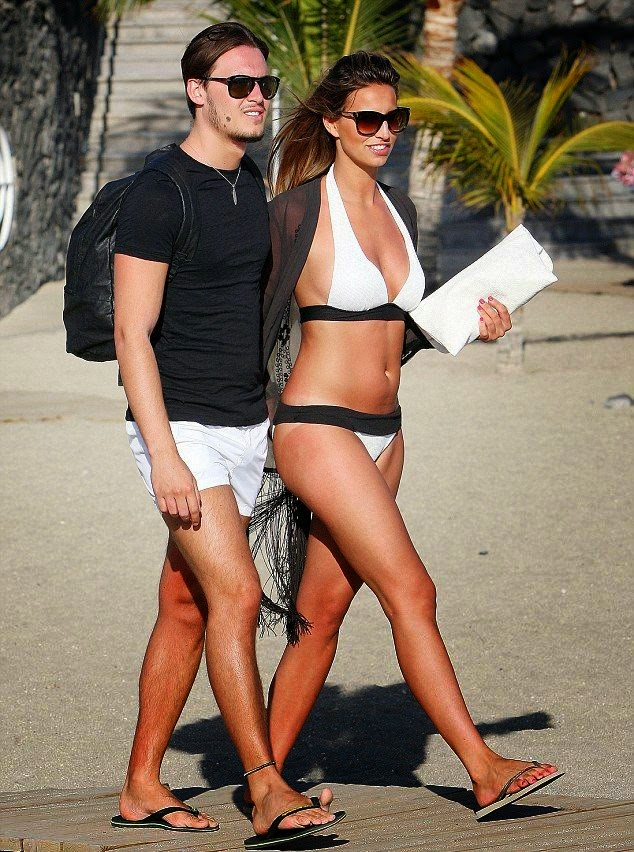 Ferne McCann headed out to the beach at Spain on Thursday, May 1, 2014 in a white bikini with her boyfriend, Charlie Sims.