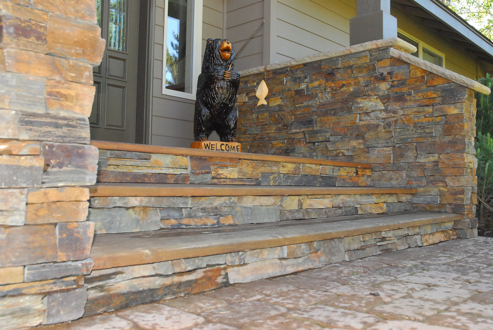 Calexia Autumn Horizon Ledgestone Natural Stone Thin Veneer Installation  With KB Industries Wall Caps And Watertable Sills.