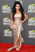 ". that immediately placed her on the ""Must Have Look for Prom 2013"" list. (snooki mtv awards)"