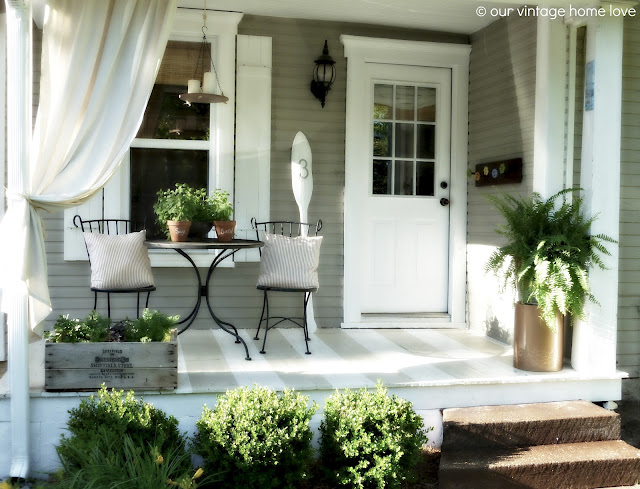 small bungalow porch idea herbs plantings taupe and white