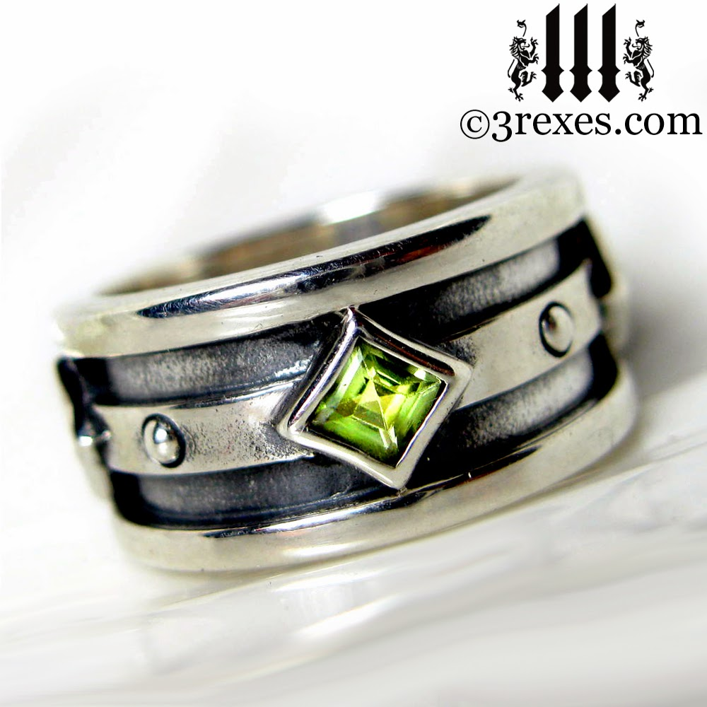 mens silver gothic engagement ring with green peridot