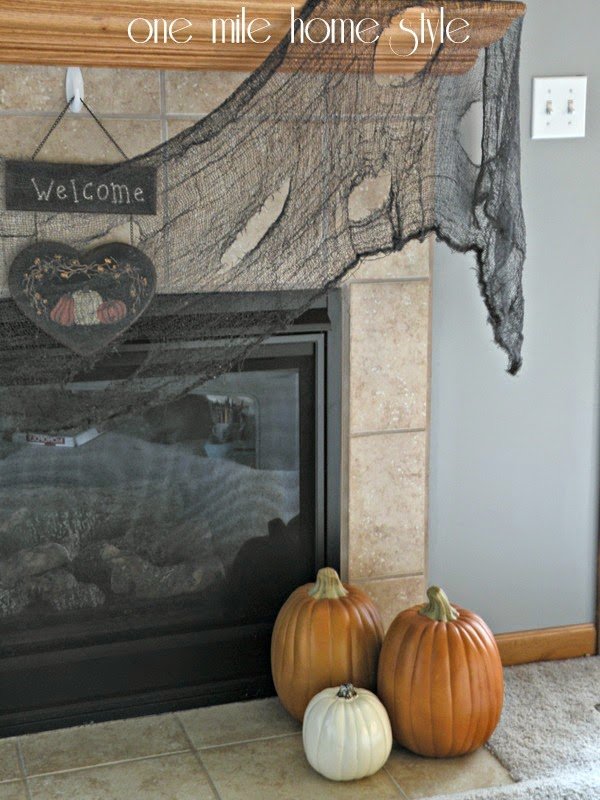 Halloween Mantel and pumpkins