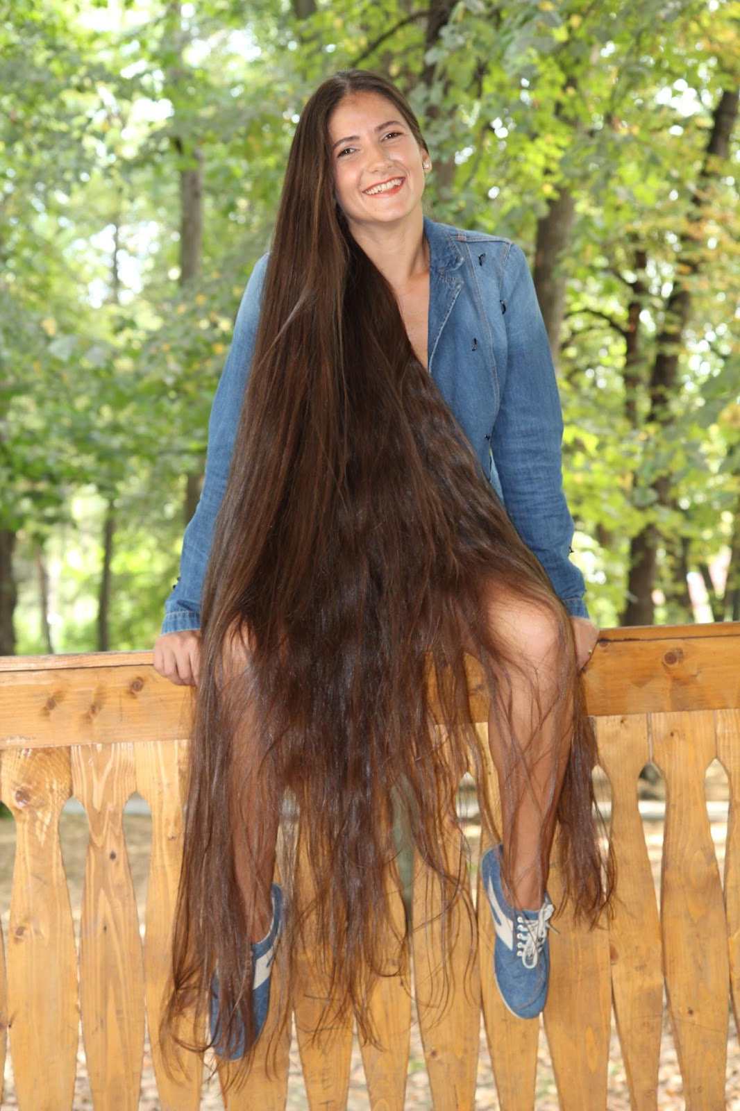 long hair girl sitting on walls for combing.