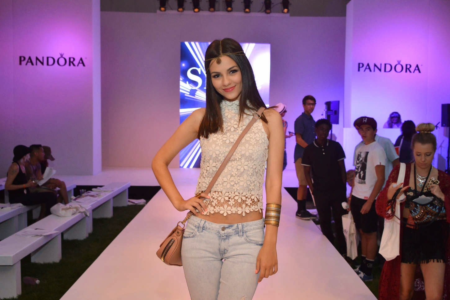 Victoria Justice in a lace cropped top and jeans at the Siwy Denim Fashion Show at Palm Springs