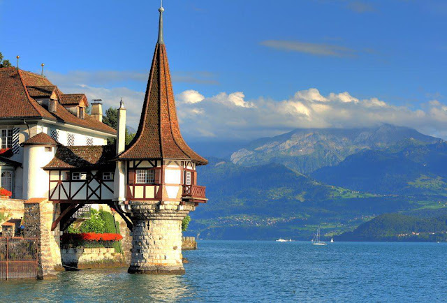 Beautiful and Worlds Best Travel Place Oberhofen Castle in Switzerland Looking Amazing Adventure Experiance with mountains and fog experiance