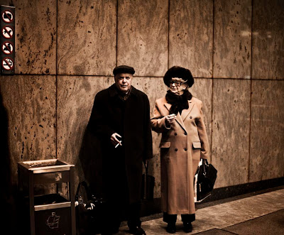 elderly couple waiting for something or someone