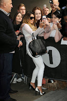 Cheryl Cole tking a photo with her fans