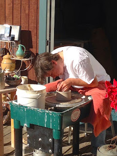 Lori Buff of Future Relics Gallery doing a pottery throwing demonstration