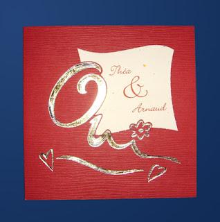 Invitación roja con dorado para boda