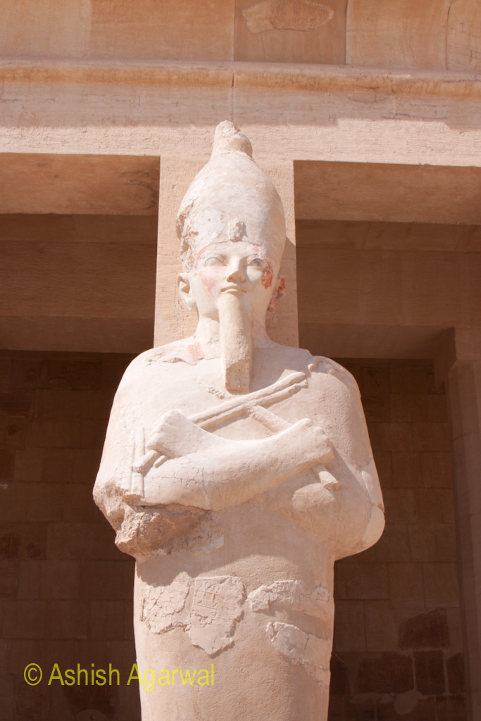 Typical pose of Pharaoh with arms folded, a statue in the Queen Hatshepsut temple in Deir El Bahri