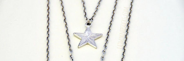 Born Pretty Store's 3-layer silver necklace features a star pendant, sun pendant, and moon pendant.