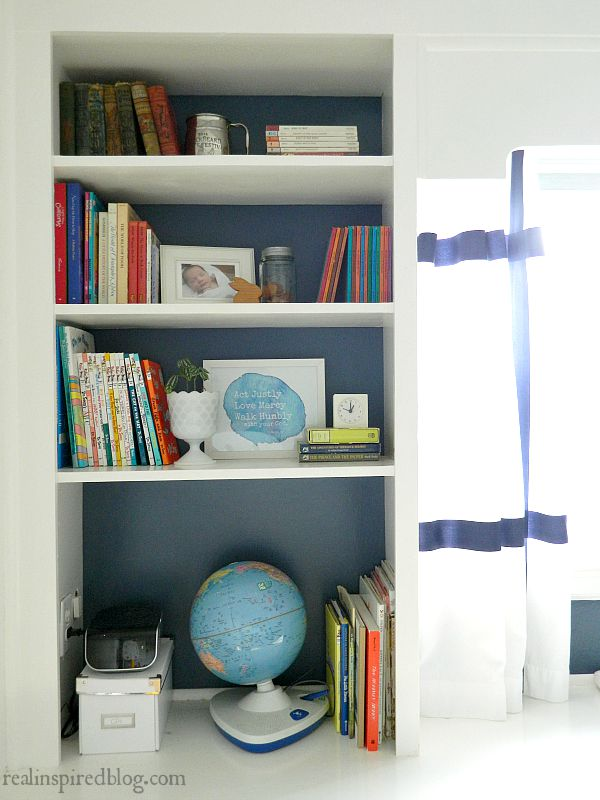 A boys' vintage modern nursery reveal! A simple makeover using a primary color palette to unify everything from toys to vintage heirlooms and sentimental objects. Painted bookshelves Built ins