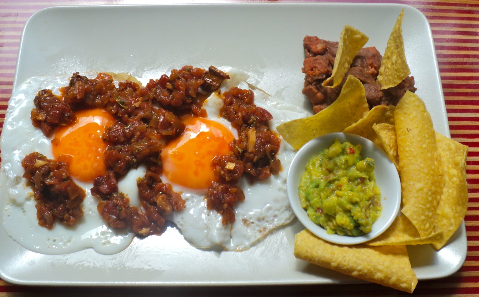 Huevos Rancheros with Chorizo Refried Beans.