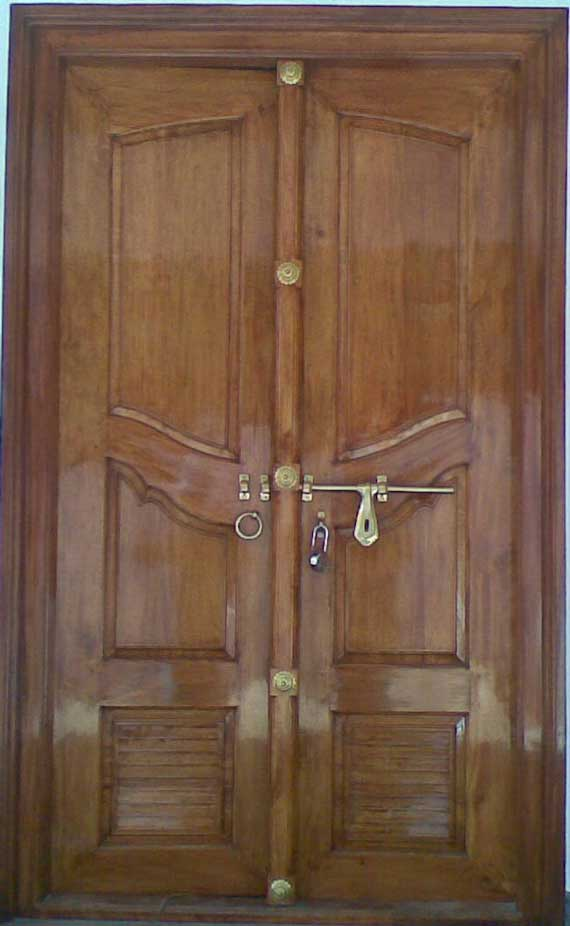Latest kerala model wooden double doors designs gallery for Wooden single door design for home