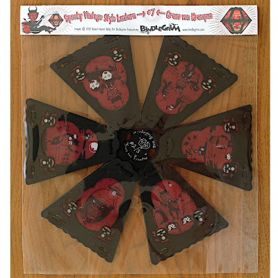 Pendant lantern #2/3 limited edition paper lantern by Bindlegrim features illustrations of the Chritsmas demon Krampus