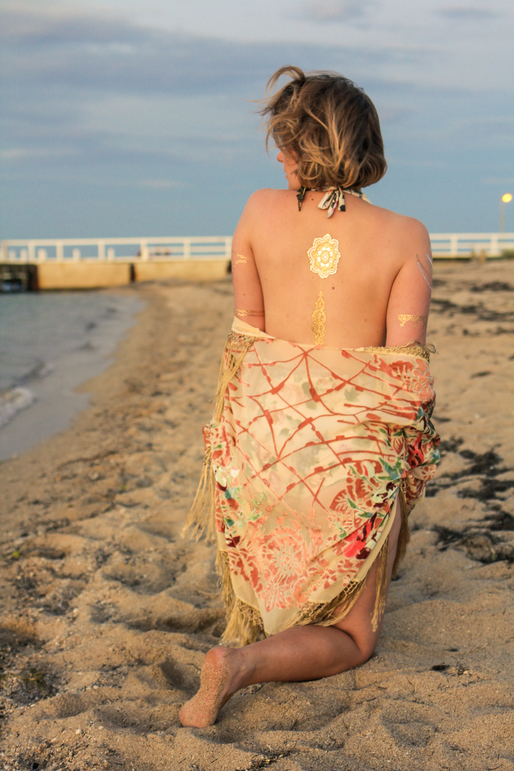 @findingfemme wears floral Bikiniboo swimsuit and flocked velvet shawl with gold tattoos.