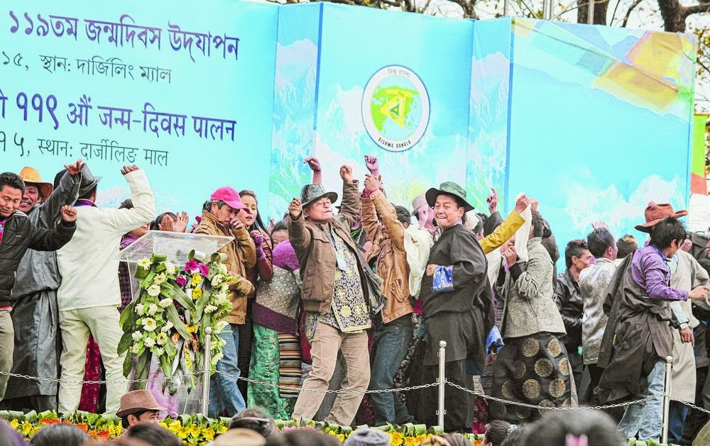 Members of the All Sherpa Association celebrate on the stage after the announcement of the Sherpa Cultural Board; and Mamata Banerjee at the programme in Darjeeling. Pictures by Suman Tamang