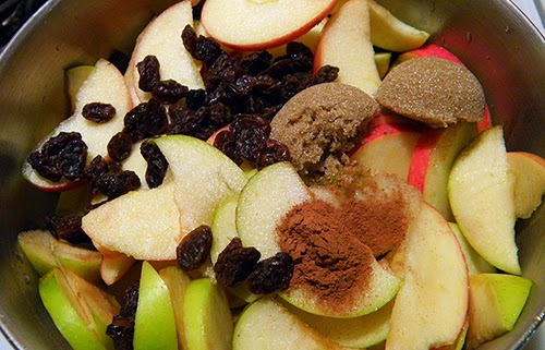 Pan with apples, raisins, sugar, and cinnamon