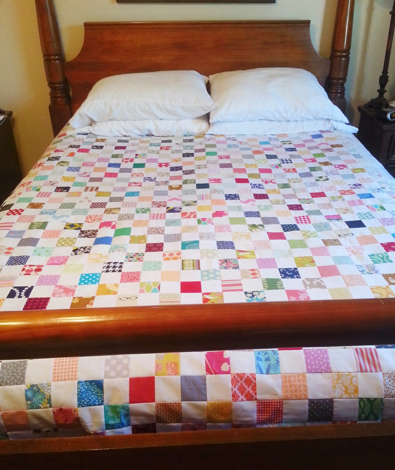 Postage Stamp Quilt on Bed