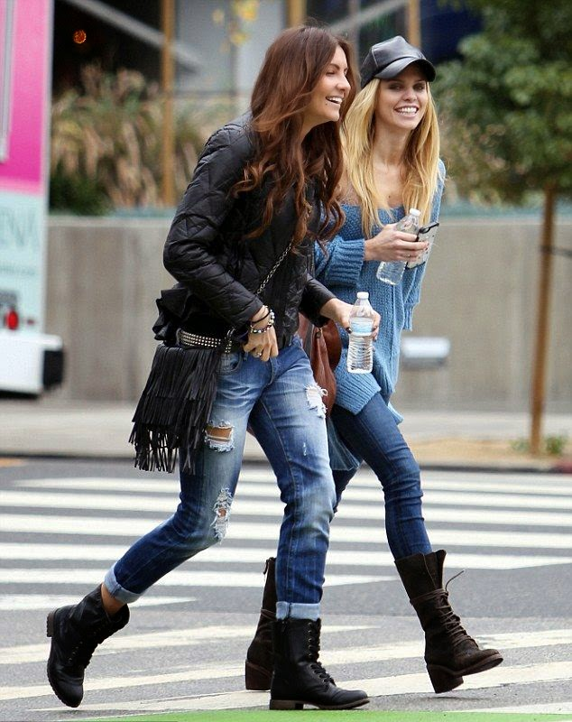The actress is walking at the street in Los Angeles, CA, USA on Tuesday, December 16, 2014 on her shopping rip with a female friend.